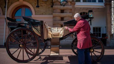 Martin Oates, Senior Carriage Restorer, polishes the Ascot Landau carriage which will carry Prince Harry and wife Meghan Markle during the procession following their wedding ceremony.
