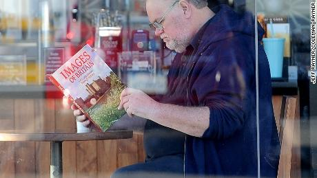 """Thomas Markle reading a book titled """"Images of Britain,"""" in an allegedly staged photo."""