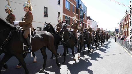 Mounted members of the Household Cavalry process through Windsor Thursday.
