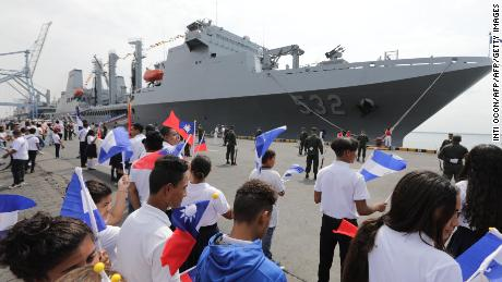 Nicaraguan students wave Taiwanese flags to welcome three Taiwanese Navy warships at Corinto port on April 9, 2018. Nicaragua is one of Taiwan's 18 remaining allies.
