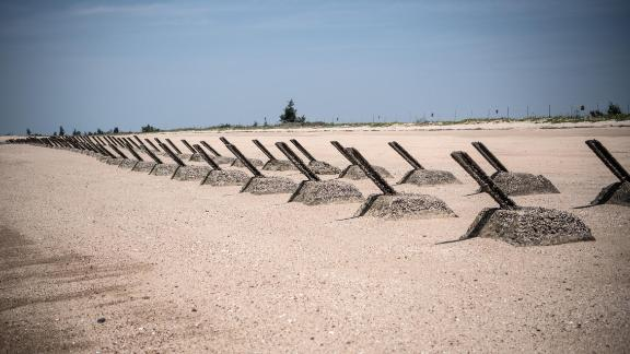 KINMEN, TAIWAN - APRIL 19: Aged anti-landing barricades are positioned on a beach facing China on the Taiwanese island of Kinmen which, at points lies only a few miles from China, on April 19, 2018 in Kinmen, Taiwan. China recently carried out live-fire military drills in the Taiwan Strait involving its Liaoning aircraft carrier, an exercise interpreted as a show of force and a message to self-governed Taiwan which China claims as its territory. The naval exercise was the first in the Taiwan Strait since 2016 and was held just over 100 miles off the coast of Taiwan. Following the defeat of the ruling Kuomintang party by the Chinese Communist Party and their retreat to Taiwan in 1949, cross-strait relations have varied from open conflict to diplomatic war. China's President, Xi Jinping, recently emphasised China's sovereignty over Taiwan by stating that 'We have sufficient abilities to thwart any form of Taiwan independence attempts'. Beijing has also imposed financial restrictions by significantly limiting the number of Chinese tour groups allowed to visit Taiwan and imposed trade sanctions on the island. (Photo by Carl Court/Getty Images)