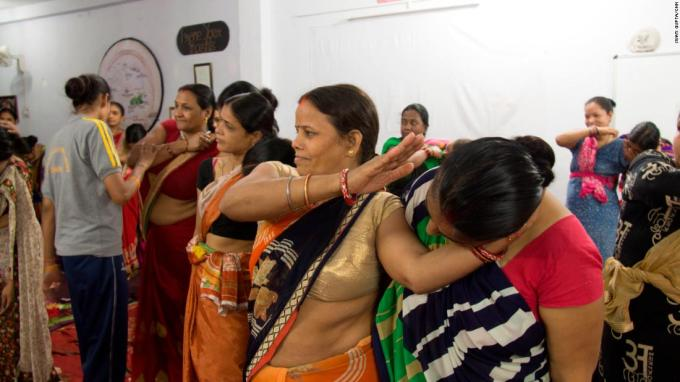 Women learn how to incapacitate an attacker in New Delhi, India.