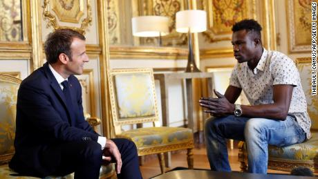 French President Emmanuel Macron (L) speaks with Mamoudou Gassama, 22, from Mali, at the presidential Élysée Palace in Paris, on May 28.