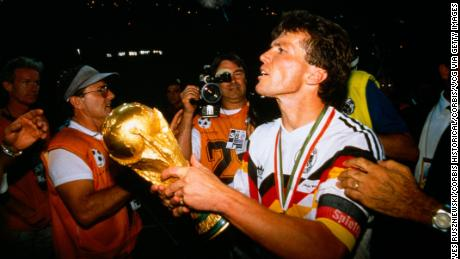 Germany captain Lothar Matthäus holds aloft the World Cup trohpy after defeating Argentina 1-0 in 1990.
