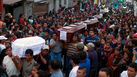 People carry to the cemetery the coffins of seven people who died during the eruption of the Volcan de Fuego, on June 4.