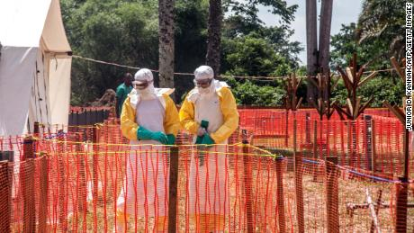 Health workers operate within an Ebola safety zone in the Health Center in Iyonda, near Mbandaka, DRC in June.