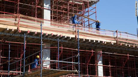 Workers construct the new government hospital in the capital Mbabane funded in part and built by Taiwan.