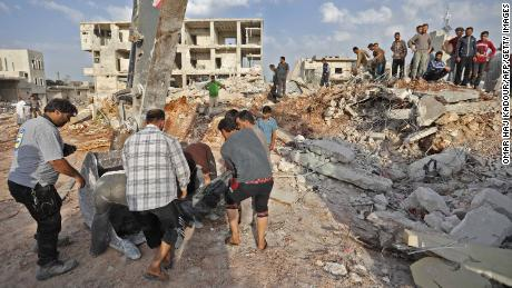Dozens reported killed in airstrikes on Syrian village