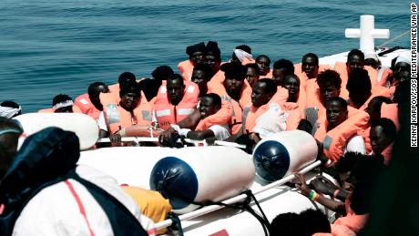 This undated photo released on Tuesday by SOS Méditerranée  shows stranded migrants from the Aquarius being transfered to an Italian Coast Guard boat before embarking on a journey to Spain.