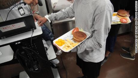A child receives a meal at the Casa Padre shelter in Brownsville, Texas.