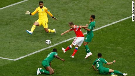 Denis Cheryshev, center, scores his side's second goal.