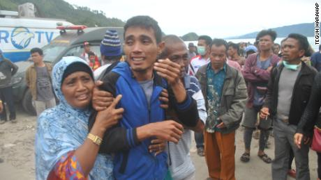 Families await news of their loved ones, thought to have drowned aboard the stricken tourist ferry.