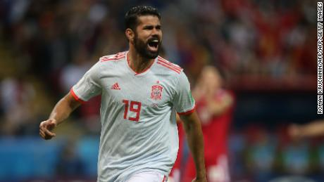 Costa wheels away in celebration after giving Spain the lead.