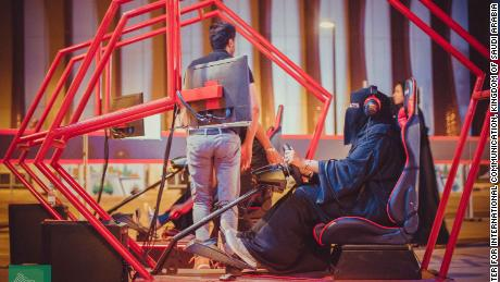 A woman tries a driving simulator at a government-organized road safety event at Riyadh Park Mall in the Saudi capital on Thursday.