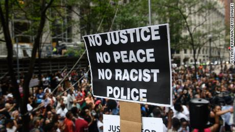 Four arrested in protest over police shooting