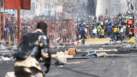 Looting broke out on the streets of Haiti's capital on July 8, after two days of deadly protests over ultimately suspended fuel price hikes.