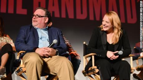 "Executive producer Bruce Miller and Elisabeth Moss speak onstage during ""The Handmaid's Tale"" Hulu finale at The Wilshire Ebell Theatre on July 9, 2018 in Los Angeles, California."