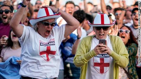 England fans celebrate their team's first goal in the city of Brighton.