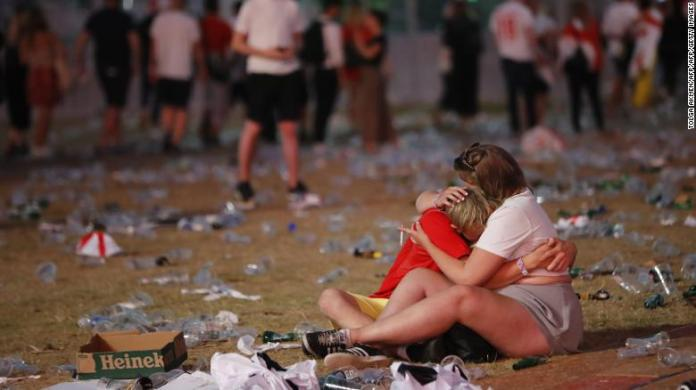 England supporters control each other at Hyde Park