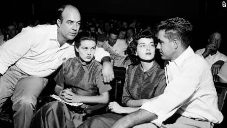 In this September 1955 photo, J.W. Milam, left, and Roy Bryant, right, sit with their wives, Juanita and Carolyn, in a Sumner, Mississippi, courtroom.