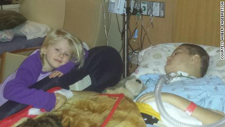 Alyssa Gilderhus with her younger sister resting at the Mayo Clinic.
