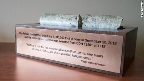 A core sample from the proposed Pebble Mine is mounted in the company offices above a quote from Ralph Waldo Emerson, a defender of the natural world.
