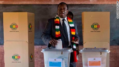 Zimbabwean President Emmerson Mnangagwa casts his vote Monday.