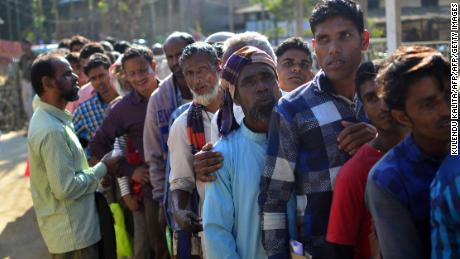 Assam is the only state in India to have a citizenship register. Villagers in Assam stand in line to check their names on the first draft of NRC earlier this year.