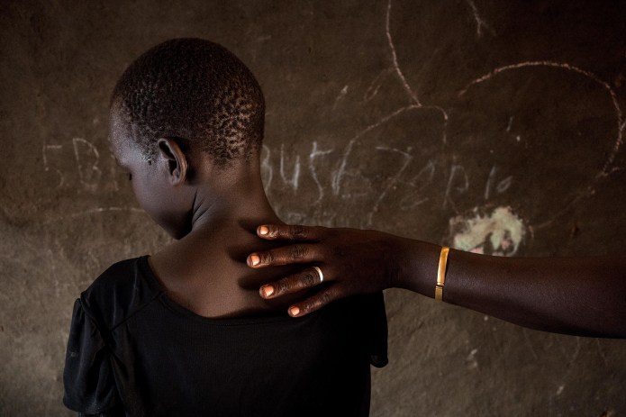 Mut's daughter, who witnessed the rape, photographed in their home at the camp.