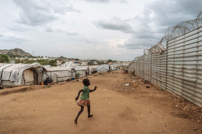 A young girl runs inside the camp, the largest in the capital city.
