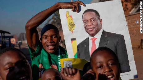 People in Mbare, a Harare suburb, celebrate Friday after officials announce Mnangagwa's victory.