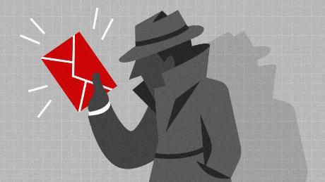 A whistleblower holding an envelope.