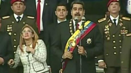 Maduro and his wife, Celia Flores, look up during the speech.