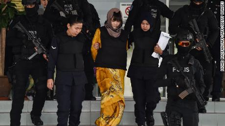 Doan Thi Huong (center) is escorted by Malaysian police at the Shah Alam High Court in Shah Alam, outside Kuala Lumpur on June  27.