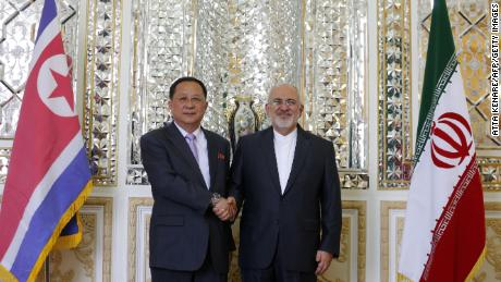 Iranian Foreign Minister Mohammad Javad Zarif, right, greets North Korean Foreign Minister Ri Yong Ho in Tehran on Tuesday.