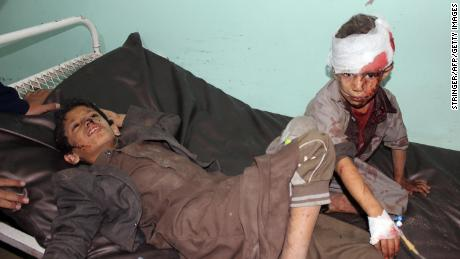 Children receive treatment at a hospital following Thursday's airstrike.