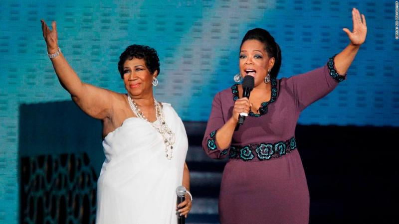 """Franklin and Oprah Winfrey during a star-studded taping of """"Surprise Oprah! A Farewell Spectacular,"""" in Chicago in 2011."""