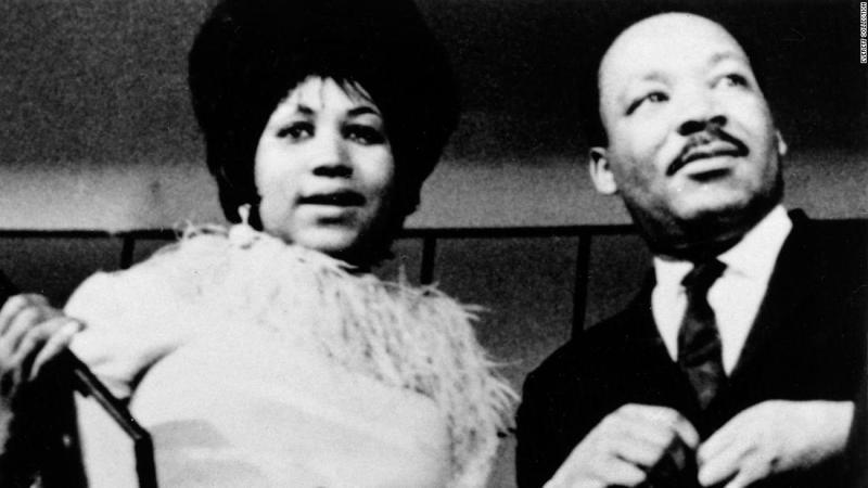 """Franklin photographed with Dr. Martin Luther King, Jr. in the late 1960's. In 1968 she was asked to perform at King's funeral, where she sang a stirring rendition of """"Precious Lord, Take Thy Hand."""""""