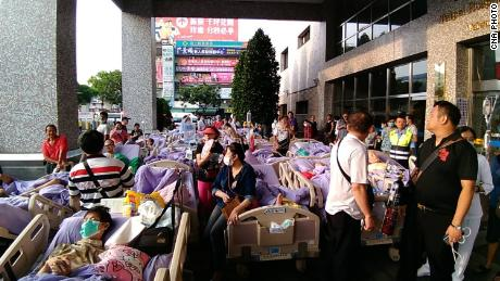 Patients were evacuated as fire spread through a hospital in New Taipei City Monday.
