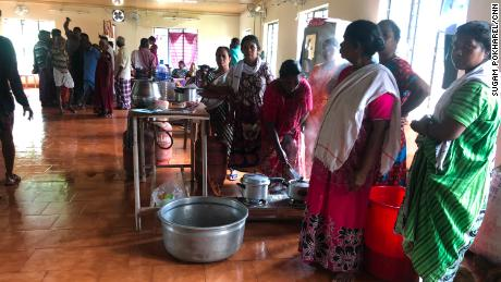 Women prepare lunch at a temporary relief camp set up in a local health center in Kerala.