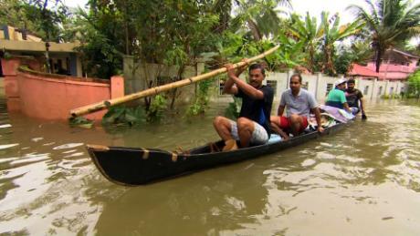 Boats are used to rescue victims of the floodwaters.