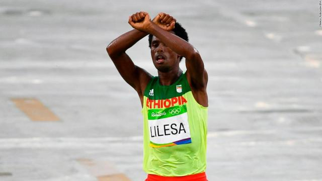 Feyisa Lilesa protests as he takes second place in the men's marathon race at the Rio 2016 Olympic Games.