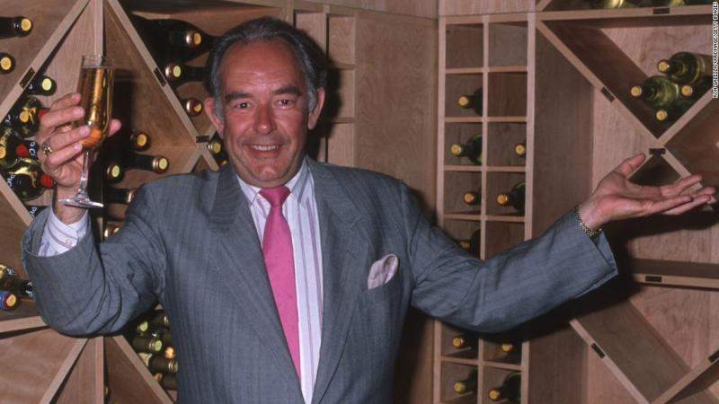 "<a href=""https://www.cnn.com/2018/08/24/entertainment/robin-leach-dead/index.html"" target=""_blank"">Robin Leach</a>, the debonair TV host who regaled audiences with talk of ""champagne wishes and caviar dreams,"" died August 24, his publicist confirmed to CNN. He was 76."