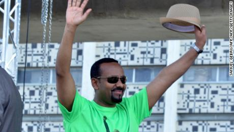 Ethiopia Prime Minister Abiy Ahmed waves to the crowd at Meskel Square in Addis Ababa on June 23, 2018.