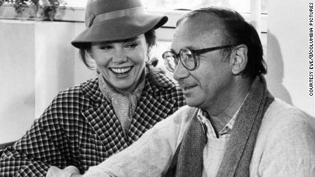 """Neil Simon with Marsha Mason on the set of """"Only When I Laugh"""" in 1981."""
