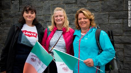 Aoibhin Meghen, 19, (left) with her mother Dearbhaile Heagney, 49, (right) and a friend on their way to the Papal Mass.