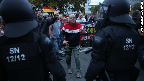 A right-wing supporter gestures to journalists during a confrontation with riot police on Tuesday in Chemnitz.