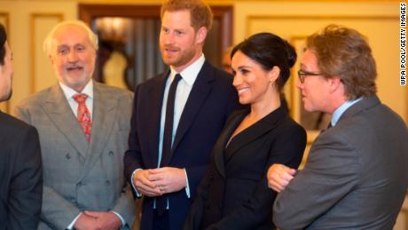 Harry and Meghan speak with Miranda and officials from the Sentebale charity.