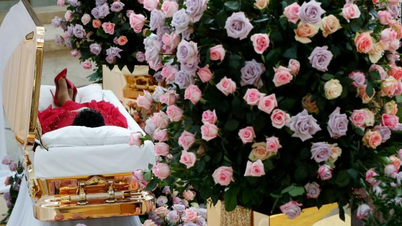 Aretha Franklin lies in her casket Tuesday at the Charles H. Wright Museum of African American History, which is in Detroit.