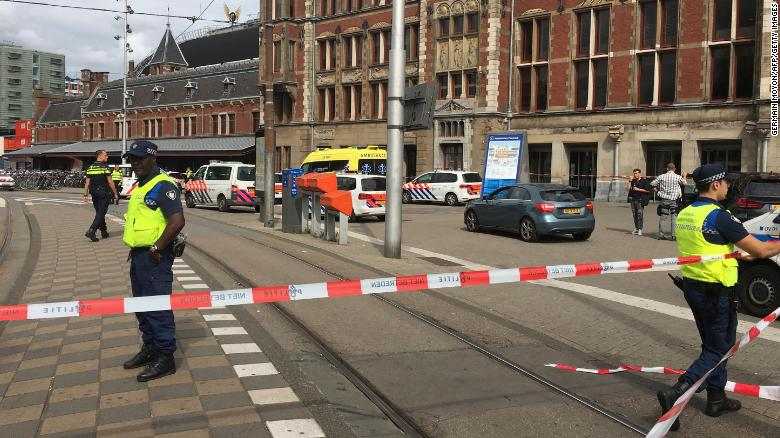 Security officials cordon off an area outside the central railway station in Amsterdam.
